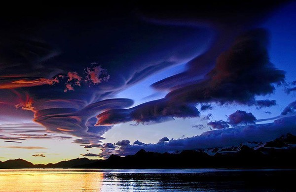 Amazing shot of lenticular clouds over Lake Crowley, California
